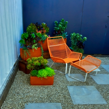 I found orange planters of various sizes to go with this chair.